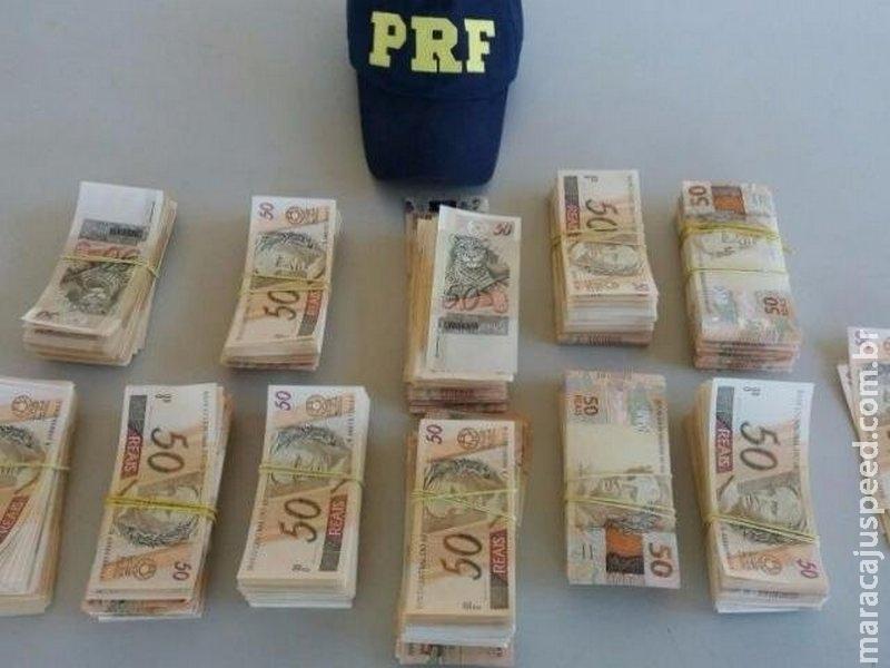 PRF encontra R$ 112 mil em notas falsas em mala dentro de ônibus